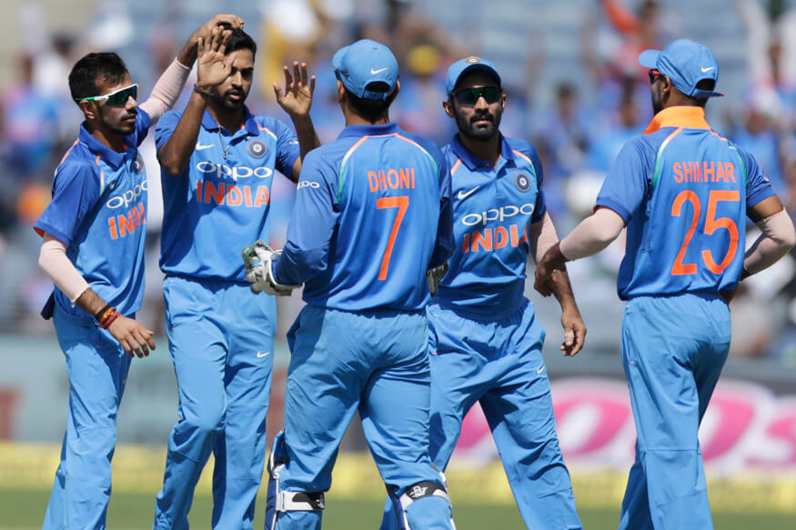 India's Bhuvneshwar Kumar second left celebrates the dismissal of New Zealand's Martin Guptill