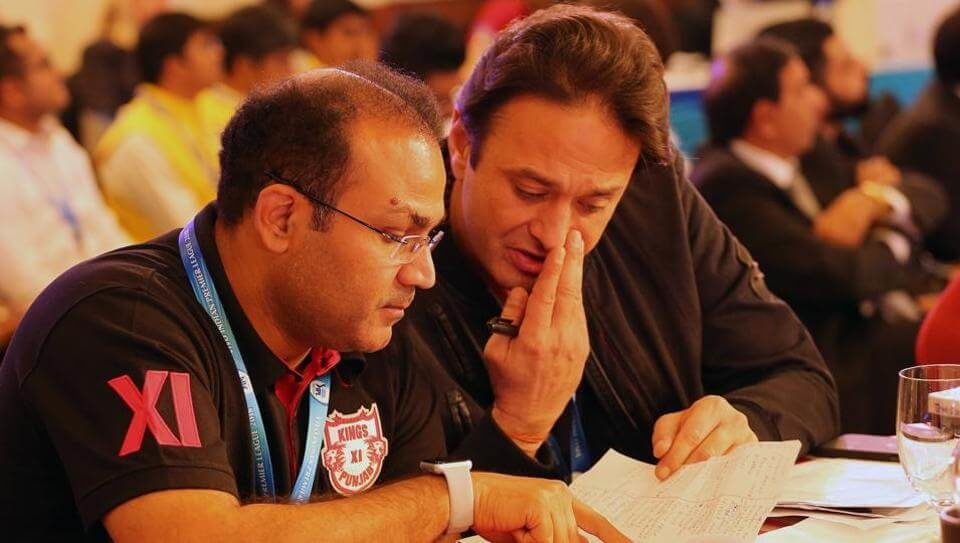 Virender Sehwag (L) and Ness Wadia in deep discussion during day 2 of the Indian Premier League (IPL) auction in Bangalore (1)
