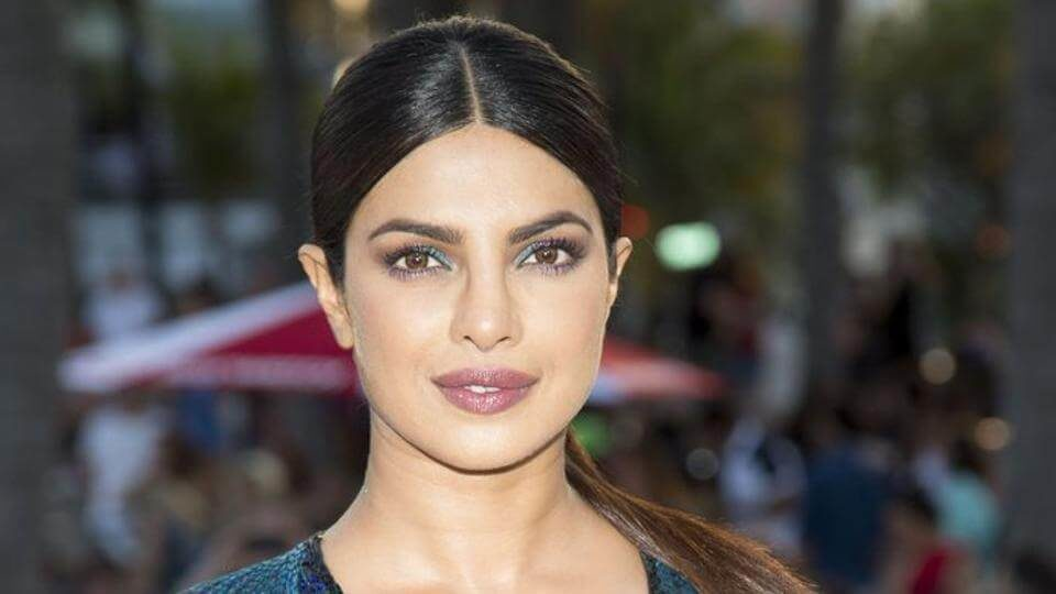 There's something arrestingly sexy about the artfully placed cutouts in Priyanka Chopra's otherwise traditional jacket and matching mini skirt two-piece
